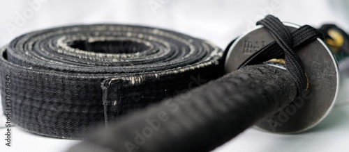 Canvas Print black belt martial arts and sword katana isolated on white background