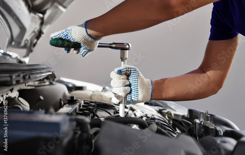 plakat Mechanic working in auto repair garage. Car maintenance