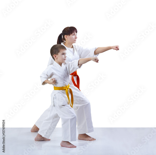 Garden Poster Martial arts With yellow and orange belt the mother and son are hitting a punch arm