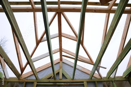 The wooden structure of the building. Wooden frame building. Wooden ...
