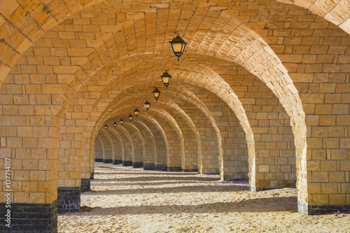 Canvas Print The arched stone colonnade with lanterns