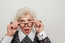 Surprised Senior Lady Adjustin...