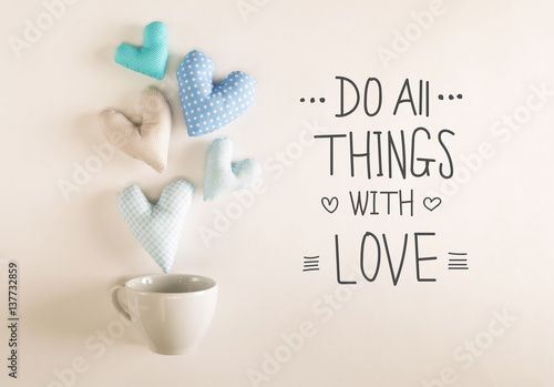 Photo Do All Things With Love message with blue heart cushions