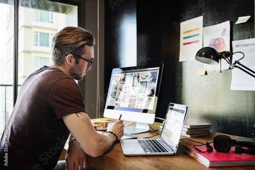 Fotografie, Obraz  Man Busy Photographer Editing Home Office Concept