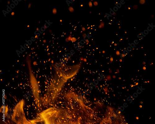 Fotobehang Vuur fire flames with sparks on a black background