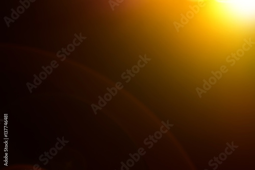 Obraz Lens flare and light beam on dark background yellow color style , photo from lens camera - fototapety do salonu