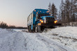 Winter landscape with forest, snow and ice road and SUV truck