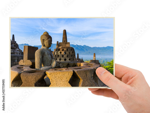Photo  Hand and Borobudur Temple in Indonesia (my photo)