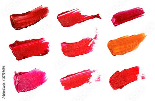 Fotografiet  Collage of decorative cosmetics  color brush lipstick strokes on white background