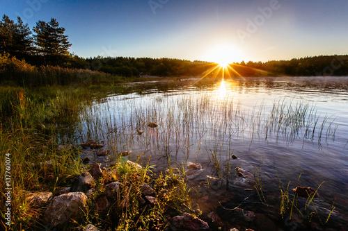 Valokuva  Beautiful sunrise in Karelia, Ladoga Lake, Russia