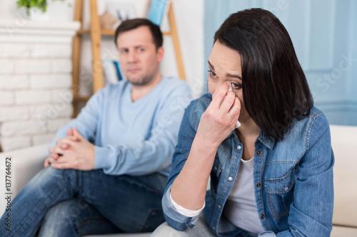 Fotografía  Depressed unhappy woman wiping her tears