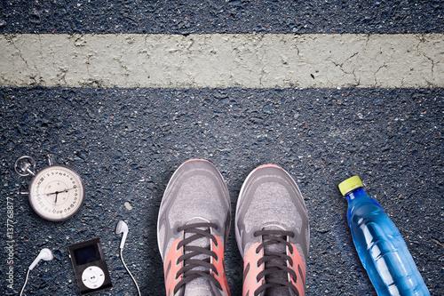 Women Running shoes and runner equipment on asphalt  Training on
