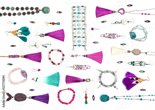 Fotografie, Obraz  Handmade turquoise and violet bijouterie with gems, tassels and feathers, lying