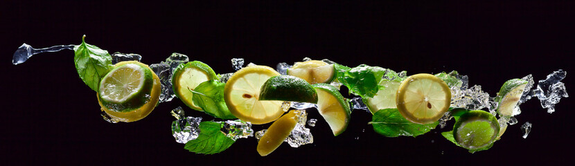 Fototapetalime , lemon and peppermint on a black background