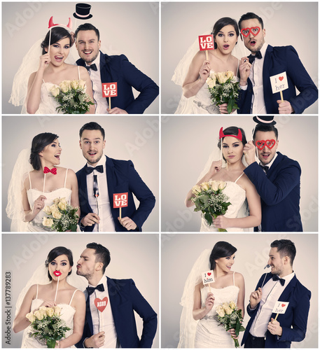Obraz Bride and bridegroom making funny faces in photo booth - fototapety do salonu