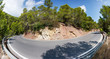 Curved road in the mountains of Ibiza, panoramic view. Car rental at Ibiza.