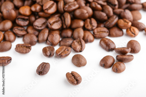 Deurstickers koffiebar roasted coffee beans isolated in white background. Roasted coffee beans background close up. Coffee beans pile from top on white background with copy space for text. Good morning.