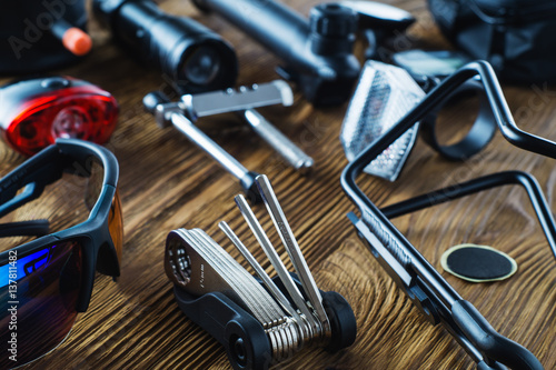 Tools and accessories set for cycling. Accessories for bicycles trips: universal screwdriver tool and screws, glasses, bicycle mirror, pump, water holder, speedometer. Bike tools and spares.