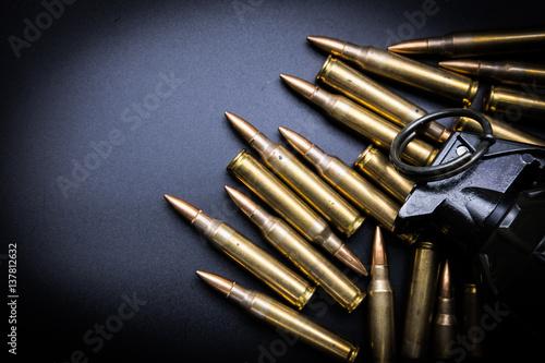 Obraz na plátně  Rifle cartridges 5.56 mm and grenade on a white background