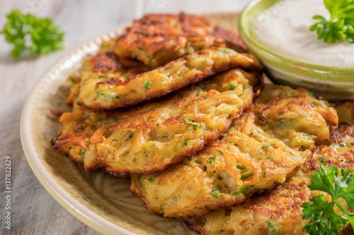 Vegetable fritters with potato, carrot, zucchini served with Ranch sauce.