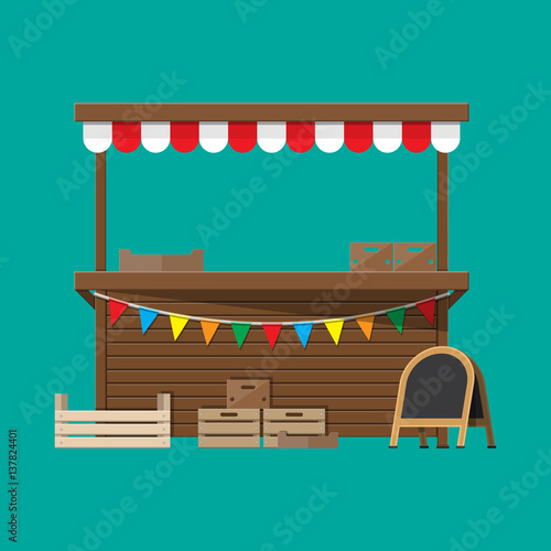 Fotografia Market food stall with flags, crates, chalk board