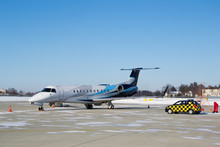 Private Business Jet And Follow Me Car