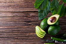 Avocado Split In Half On Old Wooden Table With Free Space For Your Text. Top View.