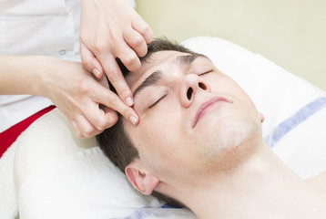 Fototapeta na wymiar Man in the mask cosmetic procedure in spa salon