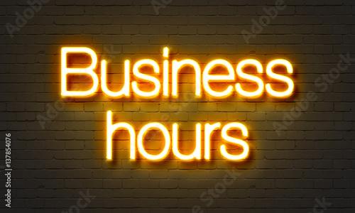 Fényképezés  Business neon sign on brick wall background.