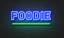 Foodie Neon Sign On Brick Wall...