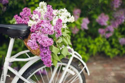 Deurstickers Fiets White retro bicycle with basket of flowers