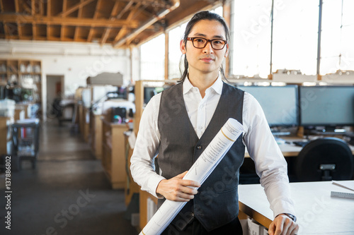 Fotografie, Obraz  Headshot of asian american man possibly architect engineer worker employee or de