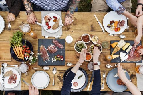 Foto op Canvas Kruidenierswinkel Group Of People Dining Concept