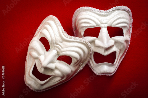 Comedy and Tragedy theatrical mask isolated on a red background