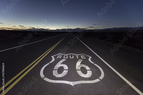 Poster Route 66 Route 66 pavement sign at night in the Southern California Mojave desert.