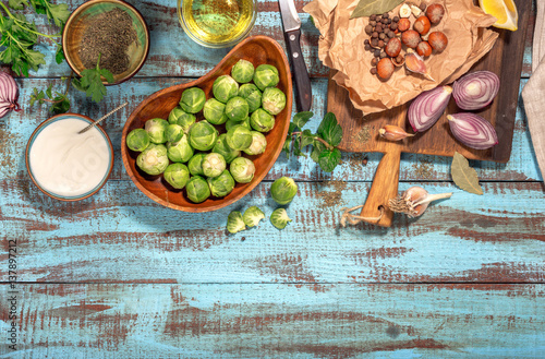 Bruxelles Brussels sprouts with ingredients for cooking healthy food with border