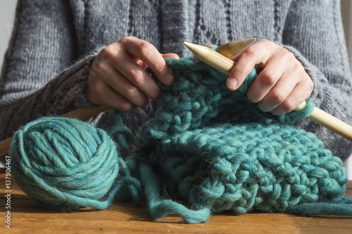 Fotografie, Obraz  Woman knitting green woolen scarf