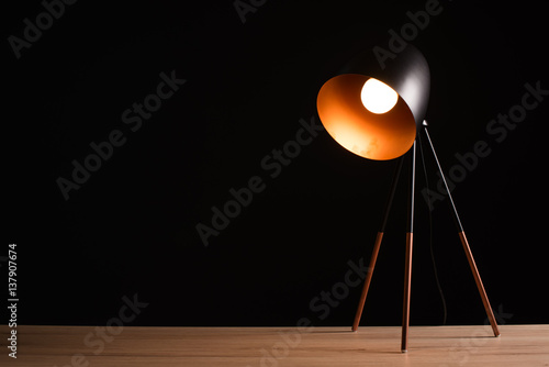 Desk lamp on empty wooden office table Poster Mural XXL
