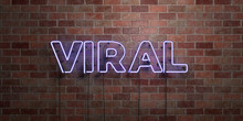 VIRAL - Fluorescent Neon Tube Sign On Brickwork - Front View - 3D Rendered Royalty Free Stock Picture. Can Be Used For Online Banner Ads And Direct Mailers..