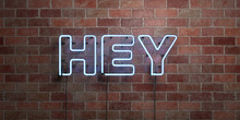HEY - Fluorescent Neon Tube Sign On Brickwork - Front View - 3D Rendered Royalty Free Stock Picture. Can Be Used For Online Banner Ads And Direct Mailers..