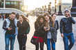 canvas print picture - Group of friends with mobile phones in London