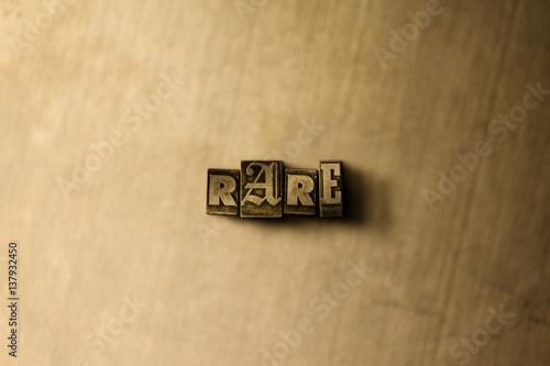 Fotografie, Obraz  RARE - close-up of grungy vintage typeset word on metal backdrop