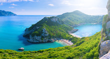 Beautiful Summertime Panoramic Seascape. View Of The Cliff Into The Crystal Clear Azure Sea Bay And Distant Islands. Unique Secluded Beach. Agios Stefanos Cape. Afionas. Corfu. Greece.
