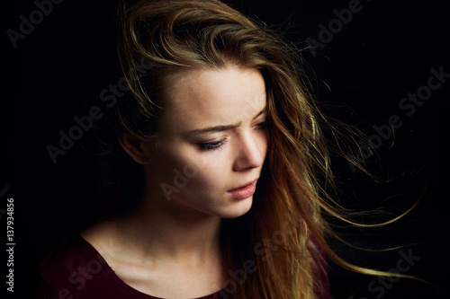 Photo  Beautiful girl looking to the side, in profile, Hair flying