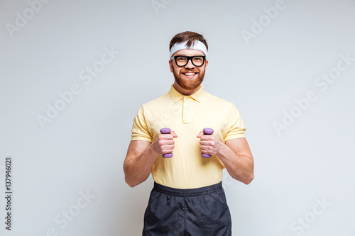 Male nerd with dumbbells Canvas Print