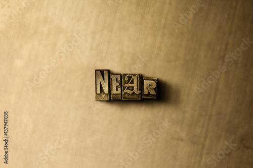 Photo  NEAR - close-up of grungy vintage typeset word on metal backdrop