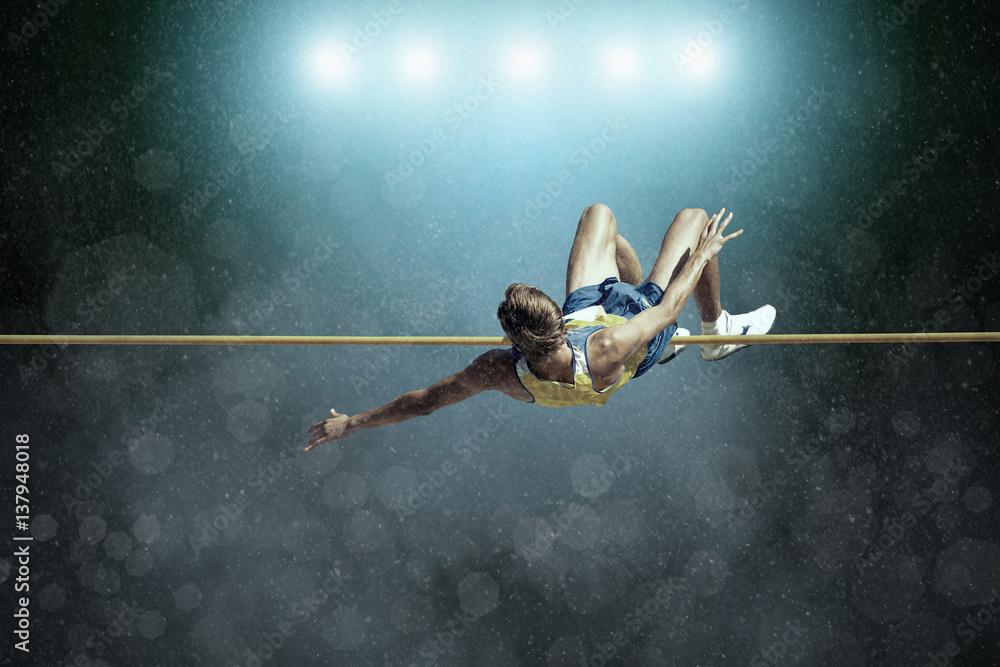 Fototapeta Athlete in action of high jump.
