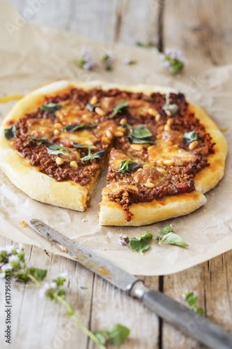 Minced meat pizza, sliced