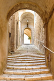 Fototapeta Uliczki - old stone steps and arch in the medieval village, Pitigliano, tuscany, italy