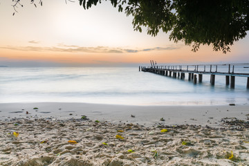 beach view with beautiful sky of sunrise and wave at ao cho, samed island, rayong, Thiland